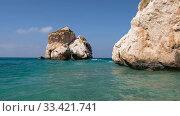 Купить «Aphrodite's Stone on Petra tou Romiou or Aphrodite Rock Beach, one of the main attractions and landmarks of Cyprus island.», видеоролик № 33421741, снято 19 марта 2020 г. (c) Serg Zastavkin / Фотобанк Лори