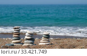 Купить «Stack of stones on Petra tou Romiou or Aphrodite Rock Beach, Cyprus», видеоролик № 33421749, снято 20 марта 2020 г. (c) Serg Zastavkin / Фотобанк Лори