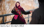 Russian folklore - cheerful woman in a beautiful scarf is dancing in the park. Стоковое фото, фотограф Константин Шишкин / Фотобанк Лори