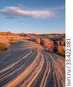 Eroded cap rock of the Curtis formation with Entrada sandstone below, in morning light. BLM Wilderness Study Area, San Rafael Desert, near Hanksville, Utah, USA. 2019. Стоковое фото, фотограф Jack Dykinga / Nature Picture Library / Фотобанк Лори