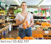 Купить «Nice woman customer choosing fresh oranges», фото № 33422157, снято 27 апреля 2019 г. (c) Яков Филимонов / Фотобанк Лори