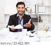 Купить «Smiling man is talking about contract», фото № 33422381, снято 29 июля 2017 г. (c) Яков Филимонов / Фотобанк Лори