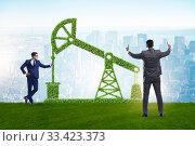Купить «Businessman and green oil energy concept», фото № 33423373, снято 30 марта 2020 г. (c) Elnur / Фотобанк Лори