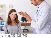 Купить «Young woman visiting male doctor oculist», фото № 33428745, снято 11 сентября 2019 г. (c) Elnur / Фотобанк Лори