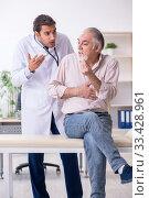 Купить «Young male doctor and old patient in antismoking concept», фото № 33428961, снято 9 сентября 2019 г. (c) Elnur / Фотобанк Лори