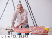 Купить «Old husband contractor in home renovation concept», фото № 33428973, снято 3 июня 2019 г. (c) Elnur / Фотобанк Лори