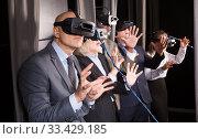 Купить «Happy man wearing VR glasses», фото № 33429185, снято 29 января 2019 г. (c) Яков Филимонов / Фотобанк Лори