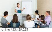 Купить «Woman presenting business project to partners», фото № 33429225, снято 25 мая 2020 г. (c) Яков Филимонов / Фотобанк Лори