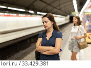 Купить «Attractive woman waiting for the subway train», фото № 33429381, снято 23 мая 2020 г. (c) Яков Филимонов / Фотобанк Лори