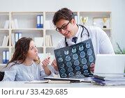 Купить «Doctor explaining to patient results of x-ray imaging», фото № 33429685, снято 12 апреля 2017 г. (c) Elnur / Фотобанк Лори