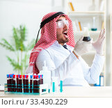 Купить «Arab chemist scientist testing quality of oil petrol», фото № 33430229, снято 21 апреля 2018 г. (c) Elnur / Фотобанк Лори