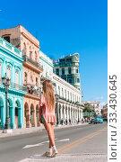 Купить «Tourist girls in popular area in Havana, Cuba. Young woman traveler smiling», фото № 33430645, снято 12 апреля 2017 г. (c) Дмитрий Травников / Фотобанк Лори