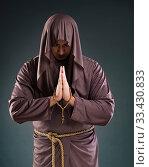 Купить «Monk in religious concept on gray background», фото № 33430833, снято 26 октября 2016 г. (c) Elnur / Фотобанк Лори