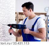 Купить «Repairman working with drilling drill perforator», фото № 33431113, снято 9 декабря 2016 г. (c) Elnur / Фотобанк Лори