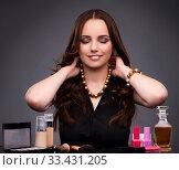 Купить «Woman doing makeup on dark background», фото № 33431205, снято 7 сентября 2016 г. (c) Elnur / Фотобанк Лори
