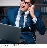 Купить «Businessman working overtime long hours late in office», фото № 33431277, снято 9 октября 2017 г. (c) Elnur / Фотобанк Лори