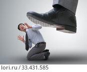 Купить «Bad angry boss stamping on employee in business concept», фото № 33431585, снято 31 марта 2020 г. (c) Elnur / Фотобанк Лори