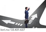 Купить «Young businessman at crossroads in uncertainty concept», фото № 33431637, снято 5 августа 2020 г. (c) Elnur / Фотобанк Лори