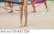 Купить «Young women teenagers giving a performance at the rhythmic gymnastics tournament using colorful ribbons», видеоролик № 33431729, снято 27 мая 2020 г. (c) Константин Шишкин / Фотобанк Лори