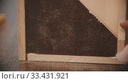 Купить «Carpentry working - hands of man worker glue together two wooden pieces», видеоролик № 33431921, снято 2 июня 2020 г. (c) Константин Шишкин / Фотобанк Лори