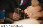 Купить «Carpentry working - man worker drilling the holes in plywood in the workshop», видеоролик № 33431929, снято 27 мая 2020 г. (c) Константин Шишкин / Фотобанк Лори