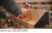 Купить «Carpentry working - hands of man worker applying glue on the wood - making a wooden organizer out of plywood», видеоролик № 33431961, снято 2 июня 2020 г. (c) Константин Шишкин / Фотобанк Лори