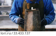 Concrete workshop - the master putsting on a form divided in two on a concrete product. Стоковое видео, видеограф Константин Шишкин / Фотобанк Лори