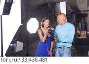Купить «Photographer showing photos on camera to model girl», фото № 33438481, снято 5 октября 2018 г. (c) Яков Филимонов / Фотобанк Лори
