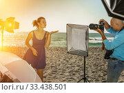 Купить «Photo shoot of glad model with photographer», фото № 33438501, снято 5 октября 2018 г. (c) Яков Филимонов / Фотобанк Лори