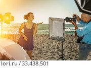 Photo shoot of glad model with photographer. Стоковое фото, фотограф Яков Филимонов / Фотобанк Лори