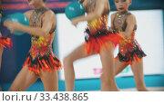 Купить «RUSSIA, KAZAN 12-03-2020, Kazan Stars Open: Young women showing their performance at the rhythmic gymnastics tournament - taking the balls from the floor and continue their performance», видеоролик № 33438865, снято 27 мая 2020 г. (c) Константин Шишкин / Фотобанк Лори