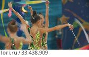 Купить «RUSSIA, KAZAN 12-03-2020, Kazan Stars Open: Young women giving a performance at the rhythmic gymnastics tournament using special colorful ribbons», видеоролик № 33438909, снято 27 мая 2020 г. (c) Константин Шишкин / Фотобанк Лори