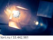 Professional orange studio spotlight hanging on the ceiling. Стоковое фото, фотограф Zoonar.com/Patrick Daxenbichler / easy Fotostock / Фотобанк Лори