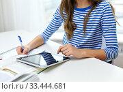 Купить «student girl using tablet pc computer at home», фото № 33444681, снято 26 февраля 2014 г. (c) Syda Productions / Фотобанк Лори