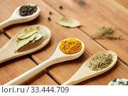Купить «spoons with different spices on wooden table», фото № 33444709, снято 6 сентября 2018 г. (c) Syda Productions / Фотобанк Лори