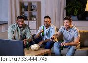 Купить «happy male friends with beer watching tv at home», фото № 33444745, снято 28 декабря 2019 г. (c) Syda Productions / Фотобанк Лори