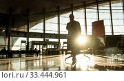 Купить «Silhouette of woman stucked at airport terminal over flight cancellation,calling family, sitting in almost empty airport terminal due to coronavirus pandemic, Covid 19, outbreak travel restrictions», фото № 33444961, снято 10 января 2019 г. (c) Matej Kastelic / Фотобанк Лори