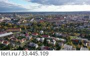 Купить «Aerial view of Olomouc cityscape overlooking Gothic spire of Saint Wenceslas Cathedral on sunny autumn day, Moravia, Czech Republic», видеоролик № 33445109, снято 16 октября 2019 г. (c) Яков Филимонов / Фотобанк Лори