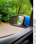Купить «Side view mirror reflection of two-lane winding road in forest, beautiful green nature close-up», фото № 33447429, снято 14 июля 2020 г. (c) easy Fotostock / Фотобанк Лори