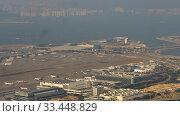 Купить «Aerial view at Chek Lap Kok airport, timelapse», видеоролик № 33448829, снято 9 ноября 2019 г. (c) Игорь Жоров / Фотобанк Лори