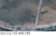 Concrete workshop - huge screw mixing dry concrete mix. Стоковое видео, видеограф Константин Шишкин / Фотобанк Лори