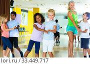 Children dancing slow ballroom dances in pairs. Стоковое фото, фотограф Яков Филимонов / Фотобанк Лори