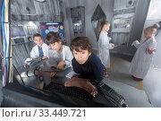 Купить «players solve task in the bunker quest room», фото № 33449721, снято 21 октября 2017 г. (c) Яков Филимонов / Фотобанк Лори
