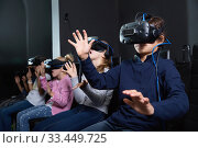 Купить «Enthusiastic children in virtual reality glasses in quest room», фото № 33449725, снято 21 октября 2017 г. (c) Яков Филимонов / Фотобанк Лори