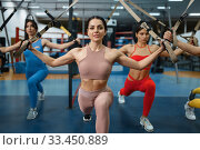 Group of attractive women doing exercise in gym. Стоковое фото, фотограф Tryapitsyn Sergiy / Фотобанк Лори