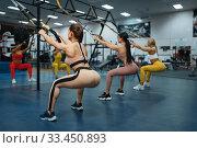 Купить «Group of women doing exercise in gym, back view», фото № 33450893, снято 13 декабря 2019 г. (c) Tryapitsyn Sergiy / Фотобанк Лори