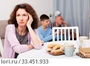 Купить «Upset woman sitting at home», фото № 33451933, снято 23 мая 2019 г. (c) Яков Филимонов / Фотобанк Лори