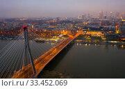 Купить «Warsaw on Vistula river with Swietokrzyski Bridge in evening», фото № 33452069, снято 10 марта 2020 г. (c) Яков Филимонов / Фотобанк Лори