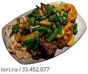 Купить «Grilled mix with baked potatoes and jalapenos», фото № 33452077, снято 8 июля 2020 г. (c) Яков Филимонов / Фотобанк Лори