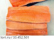 Купить «Chilled red fish steaks laid out on a store counter.», фото № 33452501, снято 2 февраля 2020 г. (c) Акиньшин Владимир / Фотобанк Лори